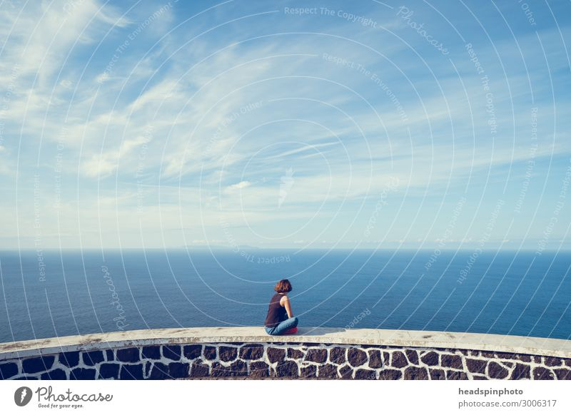 Young woman looking at sea and sky in the Azores Nature Landscape Elements Air Water Sky Clouds Beautiful weather Coast Sao Jorge Portugal Emotions Happy