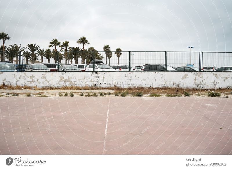 park Sporting Complex Environment Town Deserted Manmade structures Means of transport Vehicle Car Discover Vacation & Travel Old Wall (barrier) Fence Parking