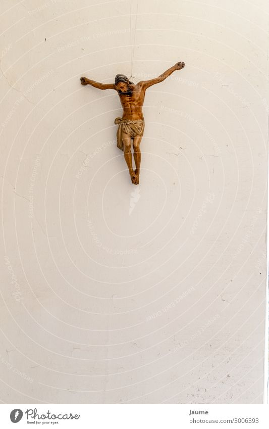 Christ on a white wall Human being Masculine Man Adults Male senior 1 Art Crucifix Religion and faith Colour photo Interior shot Day
