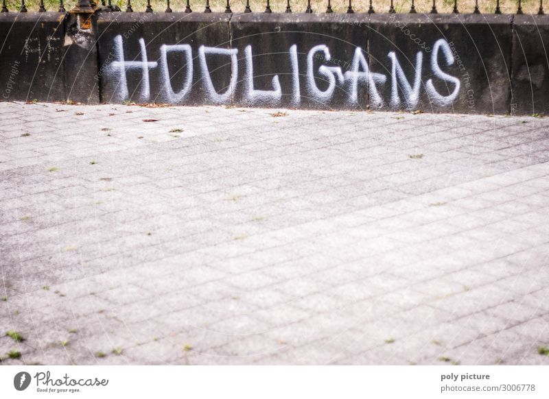 """HOOLIGANS"" Graffiti on a grey wall Town Downtown Deserted Sign Aggression Education Protection Feeble Safety Hooligan Illustration Capital letter Logo"