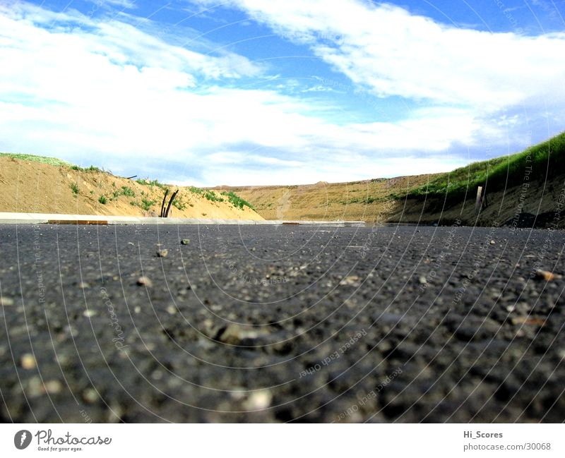 Sky Clouds Street Stone Transport Perspective Asphalt Hill Highway Pavement Worm's-eye view Tar Traffic lane Pile up