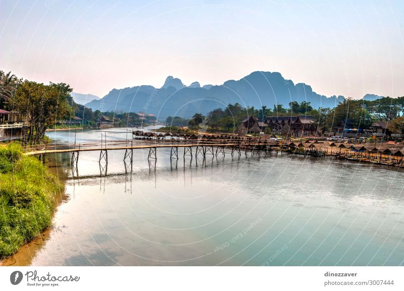 Vang Vieng with the river, Laos Vacation & Travel Tourism Summer Mountain Environment Nature Landscape Sky Clouds Lake River Village Town Skyline Bridge