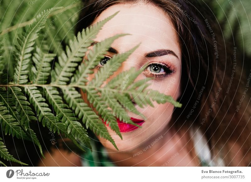 close up portrait of a young beautiful woman among green fern Woman Human being Nature Youth (Young adults) Young woman Summer Plant Colour Beautiful Green Red