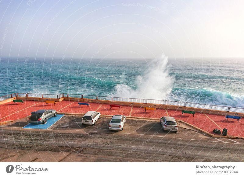 Car parking along coastline with large waves Vacation & Travel Tourism Summer Ocean Island Waves Nature Landscape Sky Weather Storm Wind Coast Street Blue