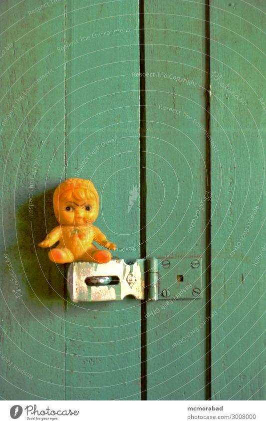Sentry on Door Latch Toys Doll Small Funny Green Orange sentry guard sentinel Patrol door fastener humourous humorous amusing Comic Vertical Colour photo