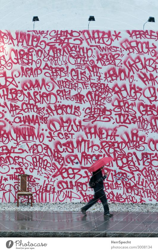 Human being Man Red Street Adults Graffiti Wall (building) Building Wall (barrier) Rain Masculine Chair Manmade structures Downtown Hip & trendy Umbrella