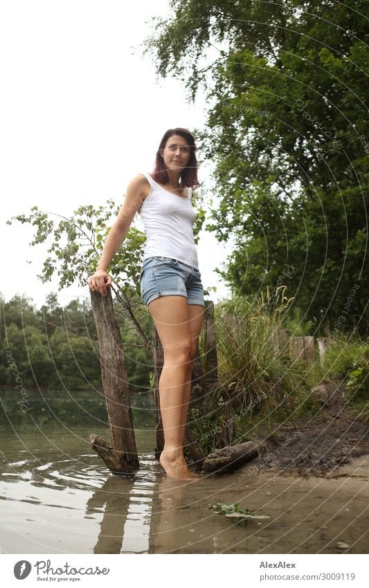 Young woman on the lake shore Lifestyle Joy Happy Beautiful Relaxation Youth (Young adults) Legs 18 - 30 years Adults Landscape Plant Summer Beautiful weather