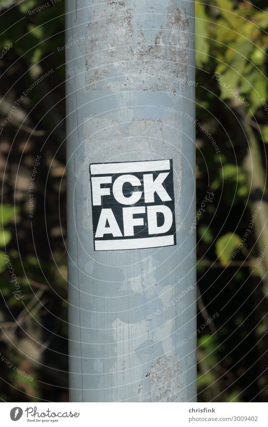 FCK AFD sticker on lantern pole Art Media Sign Characters Signs and labeling Signage Warning sign Communicate Aggression Rebellious Emotions Moody Acceptance