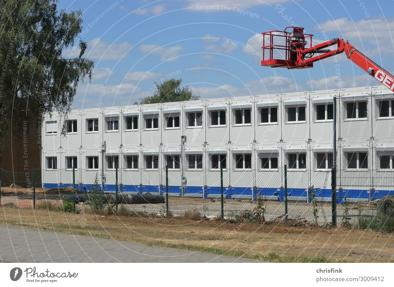 Office container on site Living or residing House (Residential Structure) Moving (to change residence) Room Economy Industry Construction site Wall (barrier)