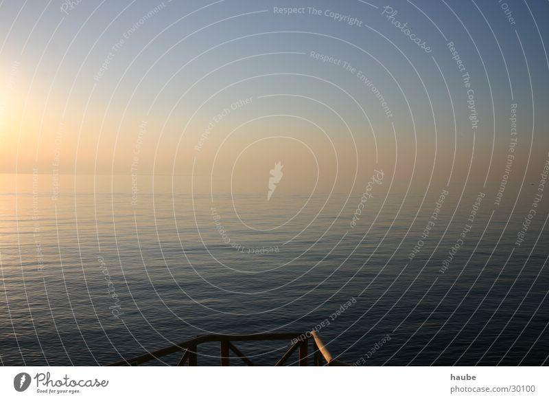calm sea Ocean Footbridge Waves Fog Sun Sky