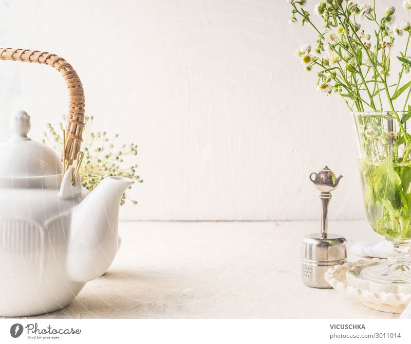 Teapot and tea strainer on a white table Food Beverage Hot drink Crockery Style Design Healthy Eating Living or residing Table Wall (barrier) Wall (building)