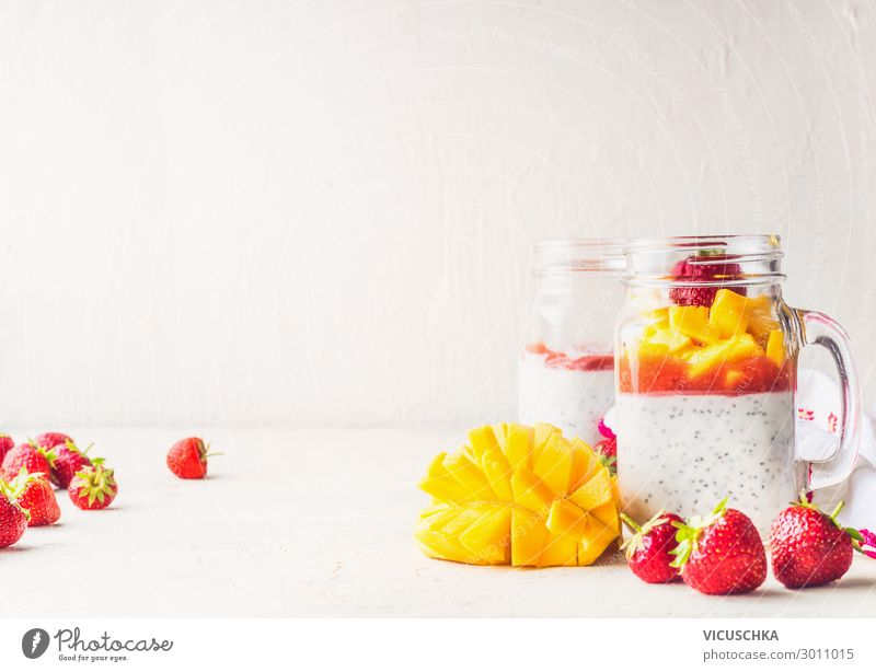 Glasses with chia seeds yoghurt, mango and strawberries Food Dairy Products Fruit Nutrition Breakfast Organic produce Vegetarian diet Diet Crockery Healthy