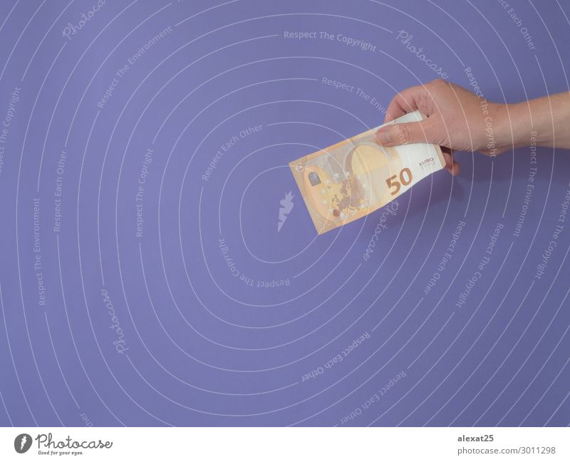 Hand with banknote of fifty euros on purple bankground with cop Shopping Money Success Financial Industry Financial institution Business Human being Woman