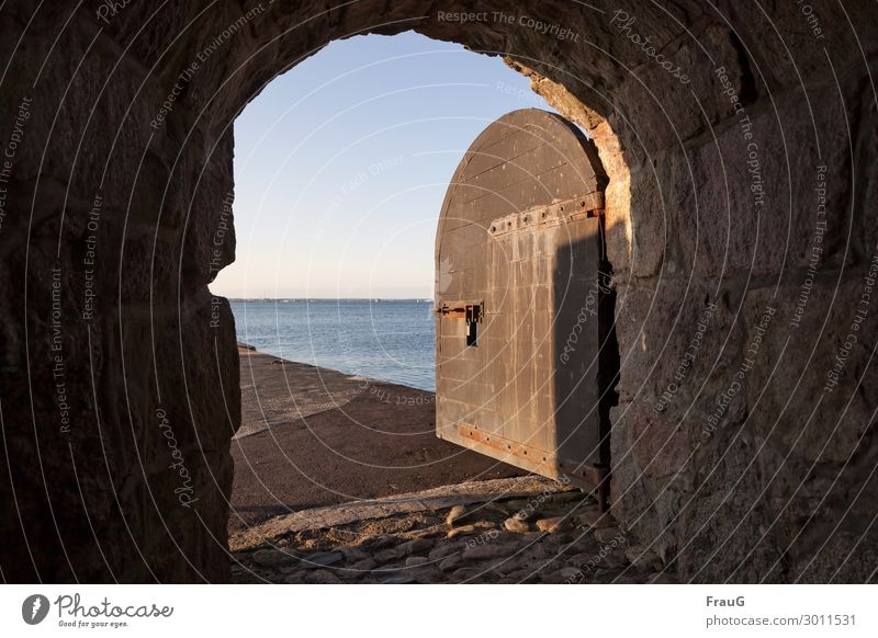 The door to the sea Vacation & Travel Summer vacation Island Water Beautiful weather Baltic Sea Ocean Wall (barrier) Wall (building) Door Old Paving stone