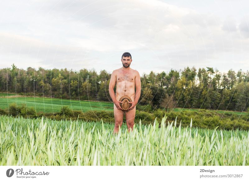 Man covering himself with summer hat at countryside Human being Vacation & Travel Nature Youth (Young adults) Naked Summer Young man Ocean Eroticism Relaxation