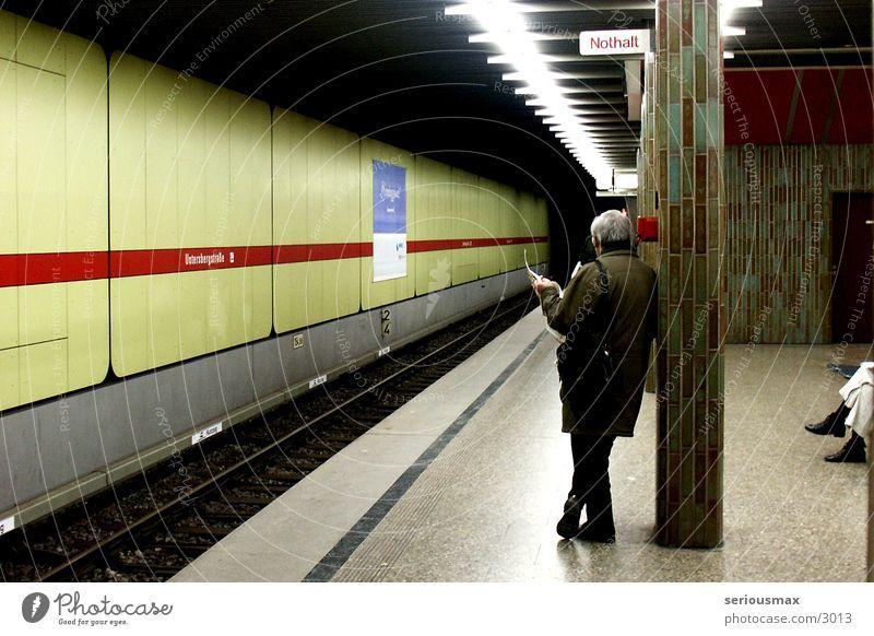 emergency stop Underground Man Newspaper Green Munich Human being
