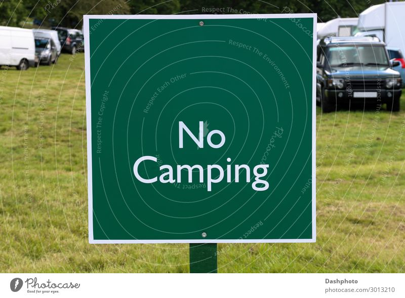 No Camping Sign at a Country Fair Vacation & Travel Landscape Tree Grass Leaf Field Vehicle Car Wood Signage Warning sign Green White Placard board warning