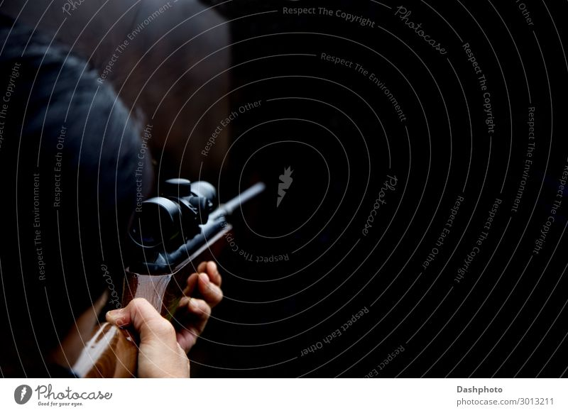 Woman Shooting at a Rifle Range Leisure and hobbies Sports Feminine Adults Head 1 Human being Wood Steel Dark Brown Black girl shooting Firearm gun Weapon