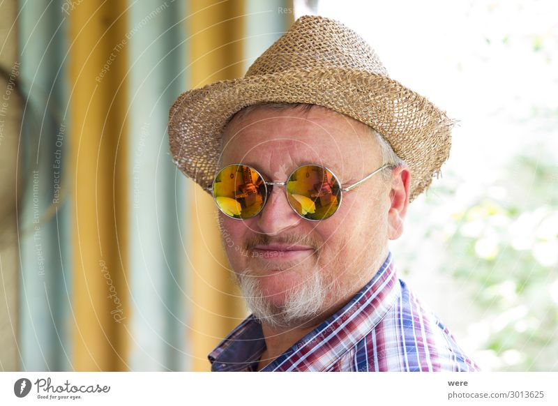 Bearded man in straw hat and mirrored sunglasses Human being Male senior Man Grandfather Senior citizen Head 1 45 - 60 years Adults Hat Facial hair Old