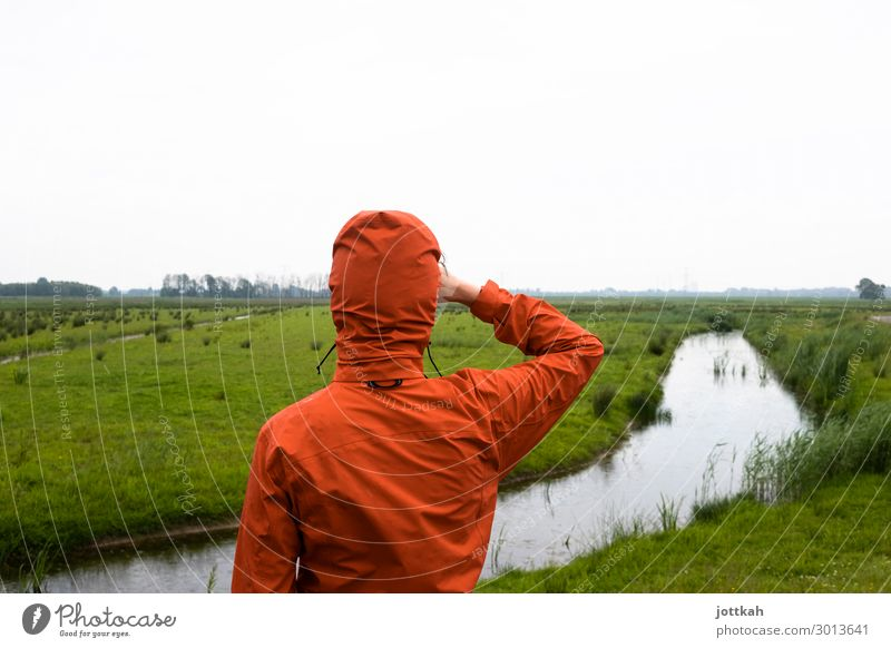 View into the distance Human being 1 Environment Nature Landscape Water Horizon Meadow Brook Observe Looking Stand Wait Curiosity Orange Anticipation Optimism