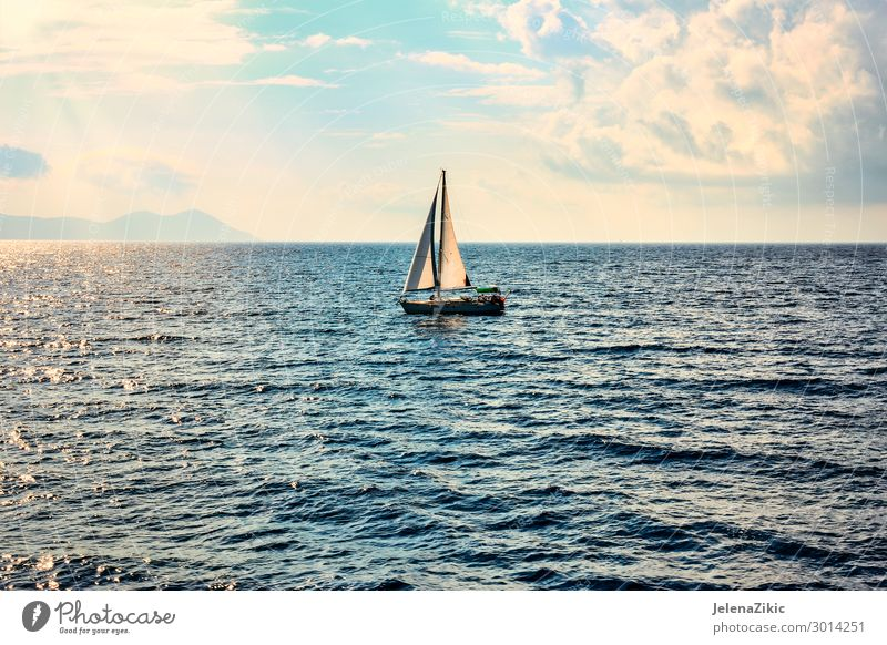 Sailing boat in the open sea Sky Vacation & Travel Nature Summer Blue White Landscape Sun Ocean Relaxation Clouds Lifestyle Sports Tourism Copy Space Freedom