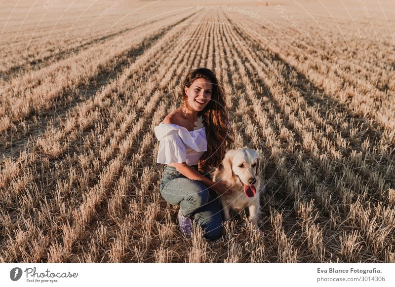 young woman with golden retriever dog on a yellow field Woman Human being Nature Dog Youth (Young adults) Young woman Summer Beautiful White Sun Animal Joy