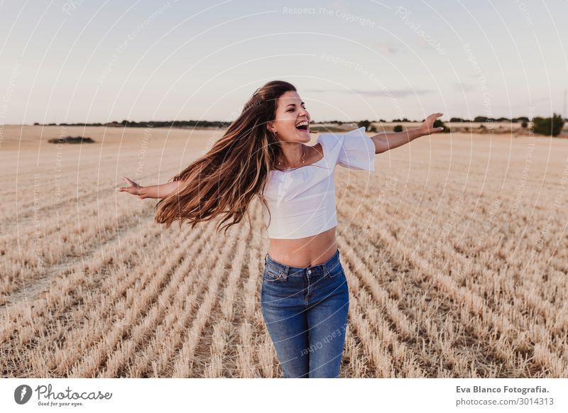 Girl enjoying on yellow field.young woman dancing Outdoors Joy Happy Beautiful Freedom Summer Sun Woman Adults Hand Nature Landscape Wind Warmth Fashion