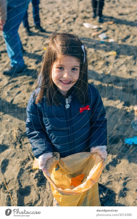 Girl showing garbage collected from the beach Woman Child Human being Hand Beach Adults Environment Happy Small Group Work and employment Sand Dirty Smiling
