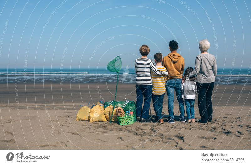 Volunteers backwards watching the sea Woman Child Human being Sky Man Old Ocean Beach Adults Environment Family & Relations Boy (child) Copy Space Group Observe