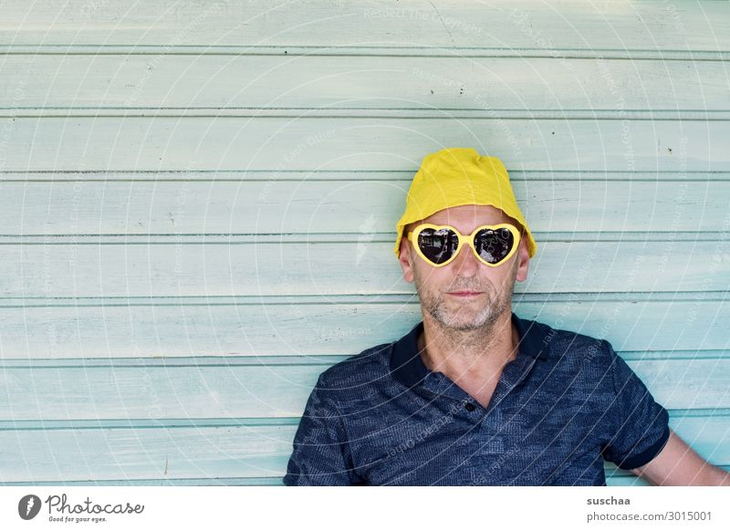 man Man Human being Portrait photograph Face Hat Sunglasses Summer Vacation & Travel Relaxation Tourist Joy Photo shoot Neutral Background Wooden wall Stripe