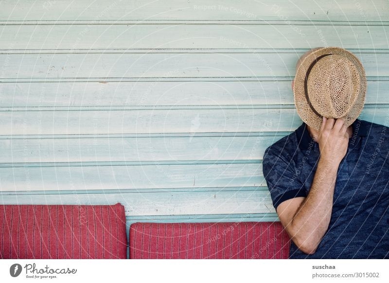 Man with hat Human being masculine Hat Unidentified without face Hide Seating Sofa Wooden wall Copy Space Striped Calm Relaxation rest Vacation & Travel