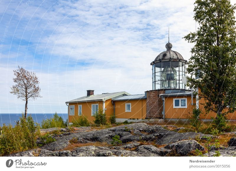Lighthouse at the Baltic Sea in Sweden Vacation & Travel Tourism Summer Summer vacation Landscape Water Sky Clouds Sun Beautiful weather Tree Grass Hill Rock