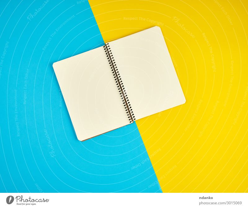 open spiral notebook with blank white pages School Office Business Book Paper Write Above Clean Blue Yellow White Idea flat Conceptual design List background