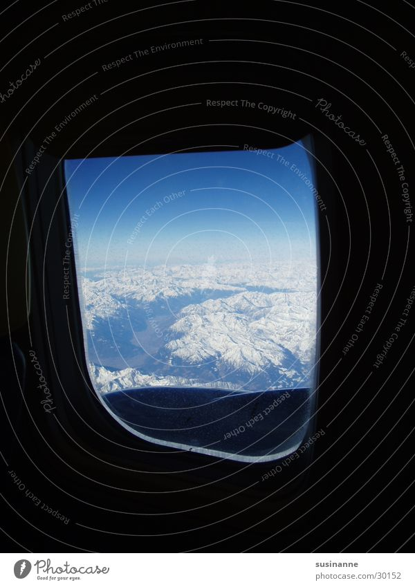 small world Window Vantage point Airplane Aviation Alps Snow Mountain