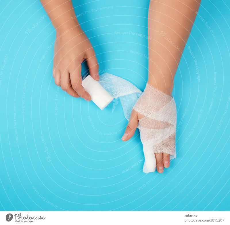 arm wrapped in a white sterile bandage Woman Human being Blue White Hand Adults Health care Body Arm Fingers Clean Protection To hold on Illness Medication Pain