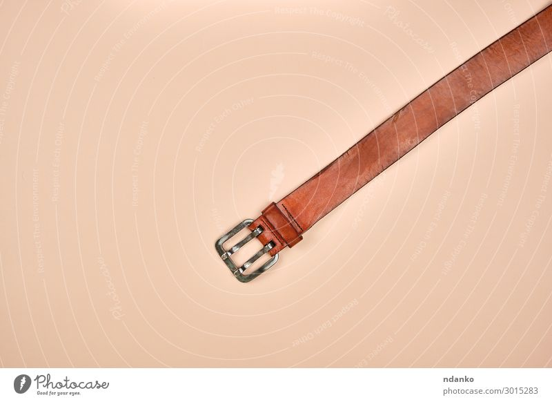 fragment of a brown leather belt with an iron buckle Elegant Style Fashion Clothing Leather Accessory Metal Modern Brown Aggression Buckle background casual