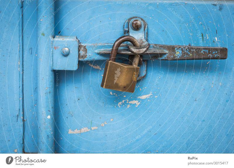 Padlock on a blue container. Design Work and employment Workplace Economy Industry Trade Logistics Craft (trade) Company Technology Science & Research Art