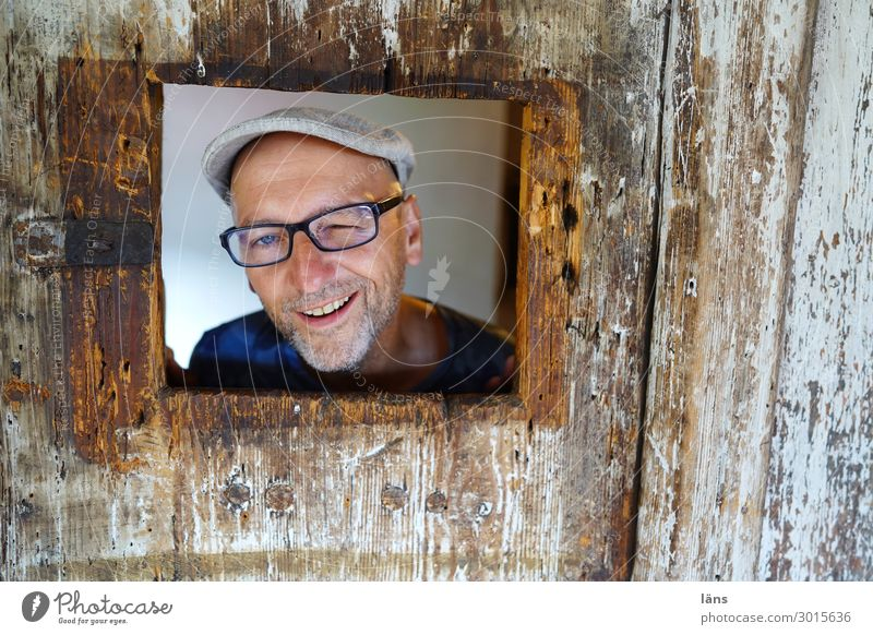 funny male portrait in wooden frame Human being Masculine Life 1 Wall (barrier) Wall (building) Eyeglasses cap Observe smile Looking Friendliness Happiness luck