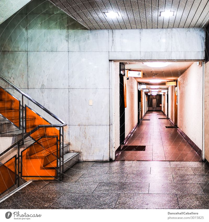 Town Dark Architecture Wall (building) Wall (barrier) Orange Gray City life Design Stairs Illuminate Door Open High-rise Arrangement Banister