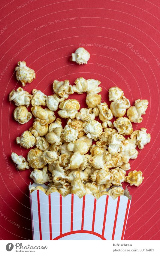 A bag of popcorn Food Candy Nutrition Fast food Finger food Entertainment Paper Packaging Select To enjoy Fresh Red Popcorn Cinema Lie Snack Maize Colour photo