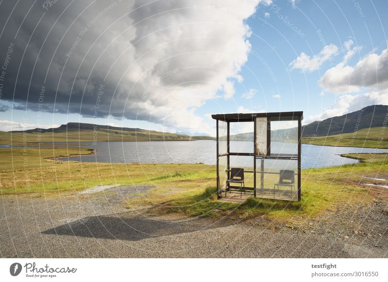 bus stops at the lake Environment Landscape Plant Animal Water Climate Hill Mountain Lakeside Wait Clouds Stop (public transport) Chair Protection Shelter Bus