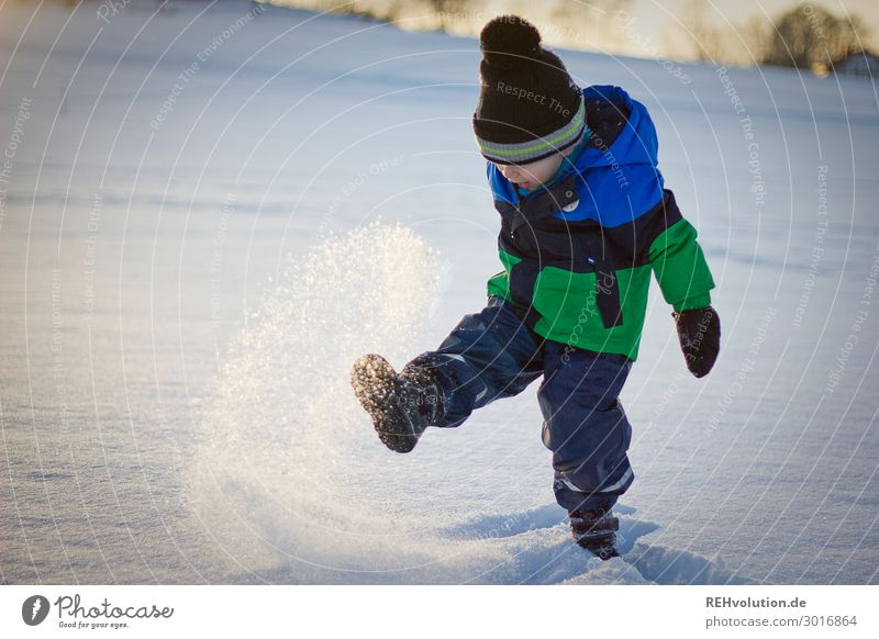Child plays in the snow Leisure and hobbies Playing Human being Boy (child) Infancy 1 3 - 8 years Environment Nature Winter Weather Beautiful weather Ice Frost
