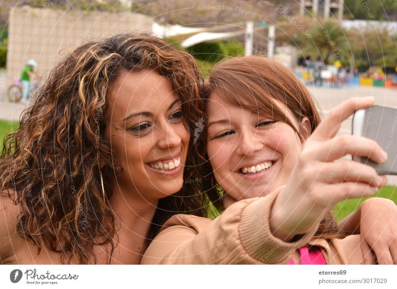 Two joyful cheerful girls taking a selfie in the street Selfie Young woman Girl Joy Friendliness Cheerful Happy Funny Woman Photography Smiling Mobile City