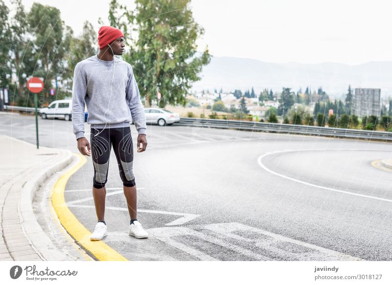Black man running upstairs outdoors in urban background Lifestyle Body Winter Sports Jogging Human being Masculine Young man Youth (Young adults) Man Adults 1