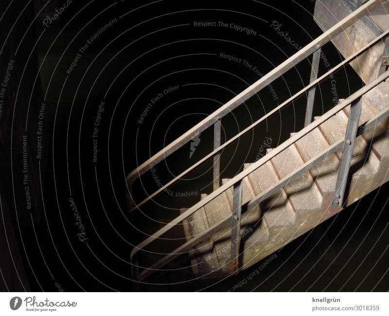 underworld Industrial plant Stairs Banister Dirty Dark Historic Gray Black Emotions Curiosity Fear Dangerous Threat Mysterious Decline Lanes & trails Downward