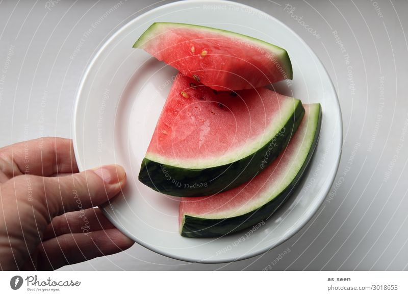 Summer refreshment Fruit Water melon Eating Buffet Brunch Banquet Vegetarian diet Diet Plate Hand To hold on Fresh Healthy Hip & trendy Round Juicy Green Red