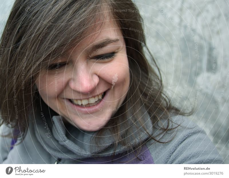 Young woman laughs Lifestyle Human being Feminine Youth (Young adults) Woman Adults Face 1 18 - 30 years 30 - 45 years Brunette Long-haired Concrete Smiling