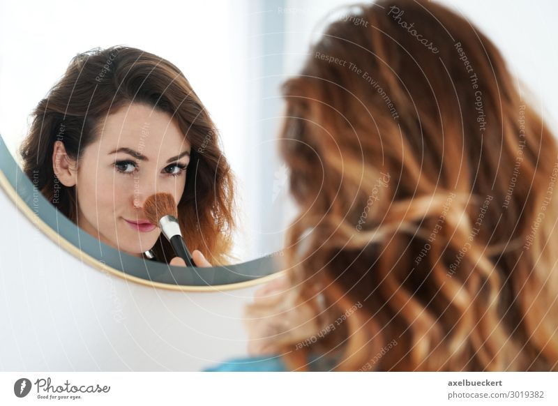 young woman powders nose in mirror Lifestyle Beautiful Skin Face Cosmetics Make-up Living or residing Mirror Bathroom Human being Feminine Young woman