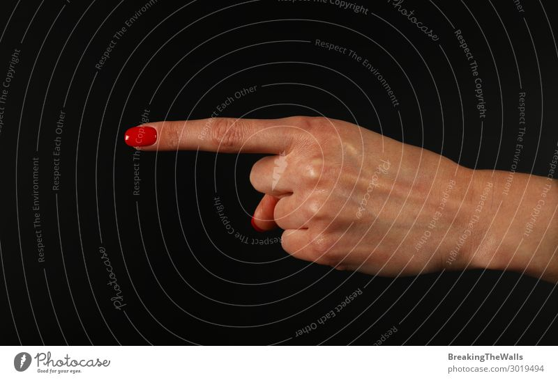 Woman hand pointing with index finger over black Human being Feminine Young woman Youth (Young adults) Adults Hand Fingers 1 Touch Aggression Red Black White