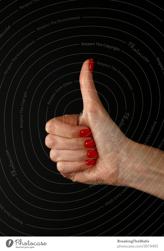 Woman hand with OK like gesture over black Human being Feminine Young woman Youth (Young adults) Adults Hand Fingers 1 To enjoy Good Red Black Acceptance Agreed